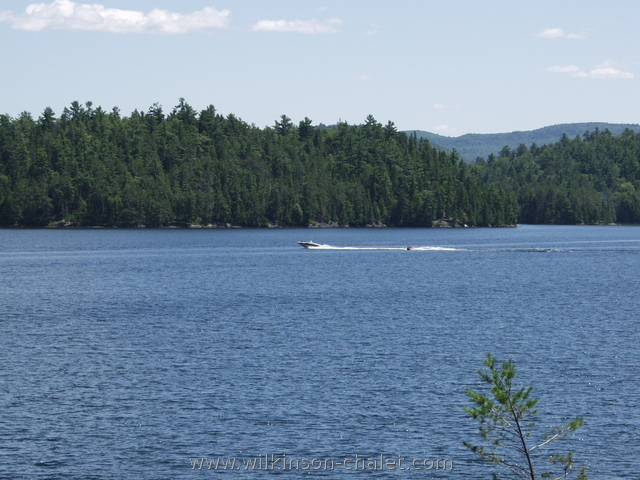 Water skiing on Mackenzie Bay, 31 Miles Lake (lac des trente et un milles) during the summer, Bouchette, Quebec